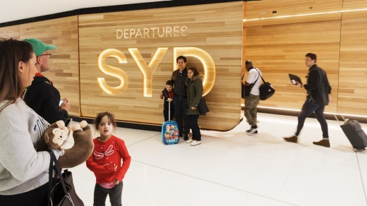 Fancy new departure gates at Sydney Airport opened late last year, but we won't be walking through them any time soon.