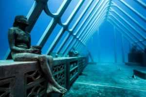 """The 72 square metre, 165 tonne skeletal Coral Greenhouse has eight human figures """"inside"""", depicting scientists, ..."""