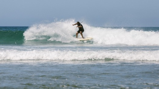 Surfing at Impossibles Beach on the Bukit Peninsula in Bali.