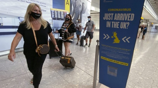 Passengers arrive at Heathrow Airport, London. People arriving from COVID-19 hotspots are supposed to self-isolate for ...