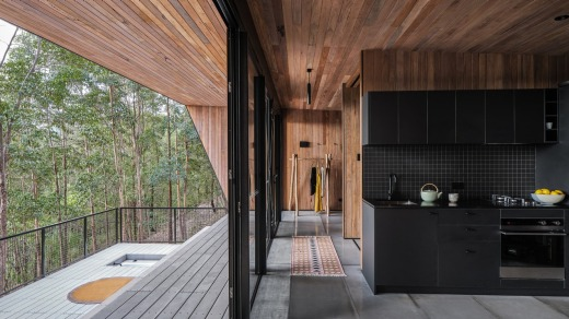 Heartwood is a striking, charcoal-toned cabin that presides temple-like over 40 hectares of bushland.