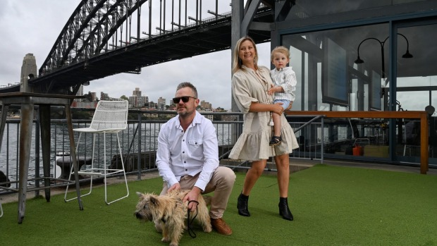 Dan and Amalie Knox with their son Darcy and terrier Scout at Pier One.