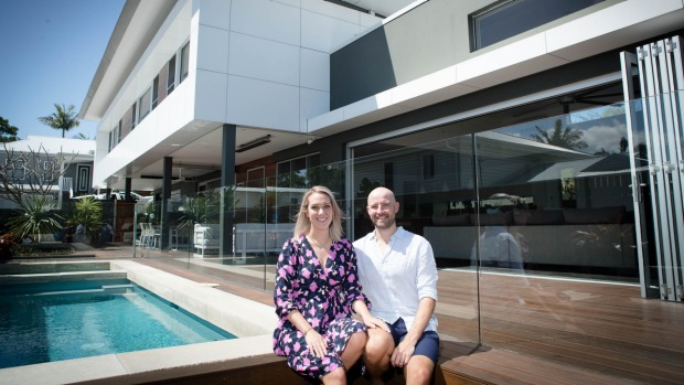 Louise Lally, with husband Ben, said her Byron Bay property was at 90 per cent occupancy this month - compared to 54 per ...
