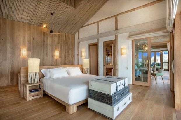 The villas are clad with sustainable wood panels while the colours of the ocean and jungle extend to the interiors with ...