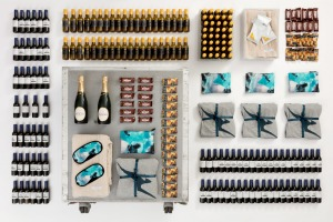 The 747 half bar cart contains 40 mini bottles of white wine and 40 mini bottles of red wine and one bottle of Champagne ...