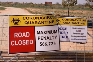 Queensland signage warns of penalties for crossing into the state from NSW at the lonely Cameron Corner border crossing, ...