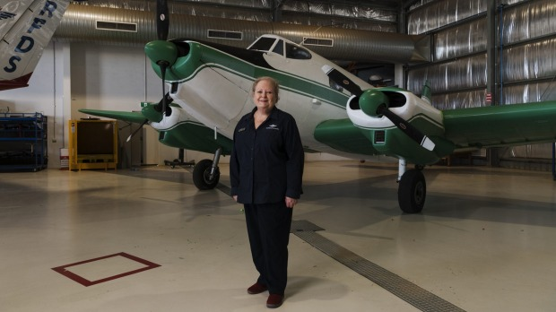 Sue Williams, from the Royal Flying Doctor Service Broken Hill visitor experience, with the service's first single-wing, ...
