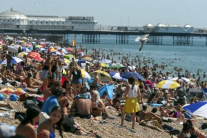 People crowd Brighton Beach in England this northern summer, showing scant regard for social distancing rules.