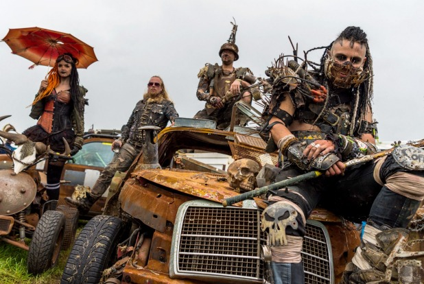 Members of the Wasteland Warriors sit  on Mad-Max-style cars on the grounds of the Wacken Open Air festival in Wacken, ...