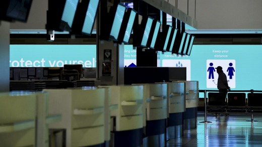 Closed check-in counters at Sydney Airport's international terminal.