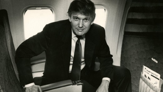 Donald Trump in the seat of one of his Trump Shuttle planes in 1989.