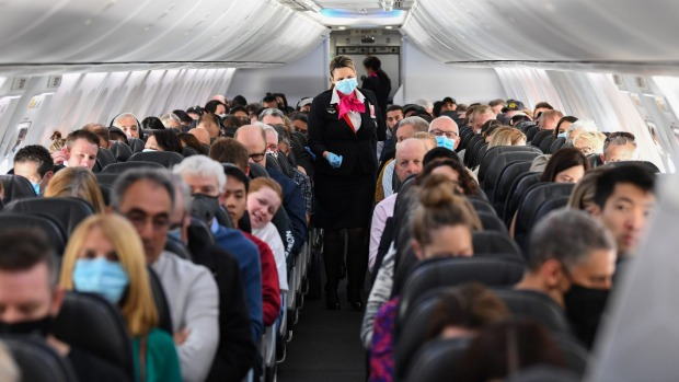 On board the first flight between Sydney and Adelaide after borders reopened last month. South Australia's decision to ...