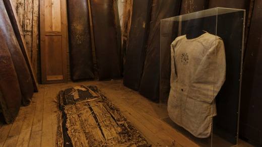 The original padded cell, for psychiatric prisoners, and a straitjacket.