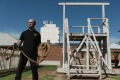 Christopher Anemaat, the gaol's visitor experience officer, shows off one of the hangman's nooses in front of the ...