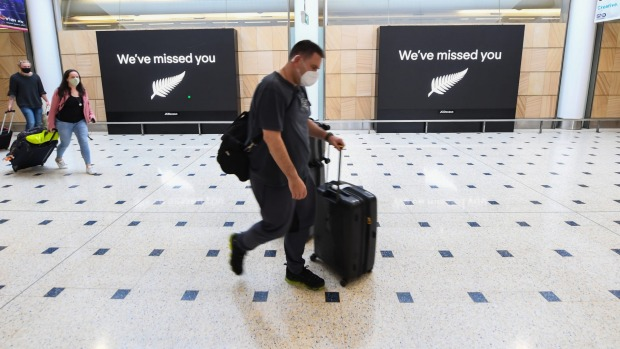 Passengers arrive at Sydney Airport from Auckland last year. New Zealanders flying home from other countries are no ...