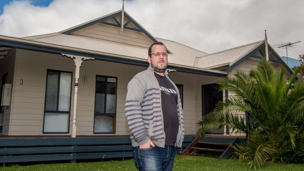 Joel Rudd, director of Phillip Island Holiday Homes, stands outside one of his holiday rentals.