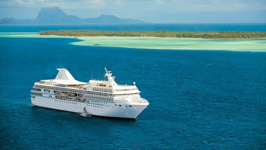 Paul Gauguin sailing in French Polynesia. The ship's small size allows her to maneuver from deep seas to shallow lagoons ...