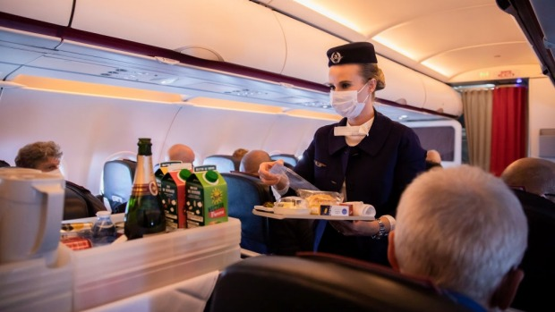Most airlines have vastly limited or wholly suspended flight attendant service of food and drinks to reduce cabin ...