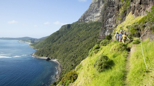 Visitors hike up Mount Gower, Lord Howe Island.