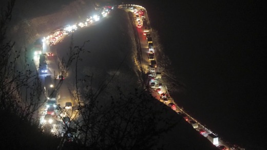 Cars and trucks stuck in a huge traffic jam climbing along the road from Kalbajar to a mountain pass leaving the ...