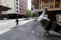 A women walks past the giant pigeon statue in an empty Rundle Mall as lockdown restrictions were imposed in Adelaide.