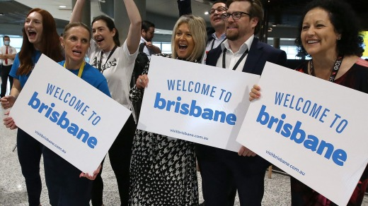 Brisbane Airport staff welcome the first passengers after borders opened in December.