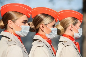 Aeroflot flight attendants wear masks at an event in October. The airline will move passengers who refuse to wear masks ...