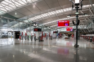 Travel restrictions have left Sydney Airport virtually empty in the lead up to Christmas - what is normally one of the ...