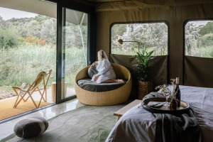The tents, some of which overlook wetlands on the 16-hectare property, feature local timber, stone benchtops, private ...