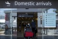 Passengers arrive at Perth Airport earlier this year. The Western Australian government has reinstated a hard border ...