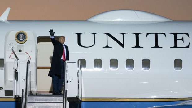 President Donald Trump waves as he boards Air Force One after speaking at a campaign rally in October.