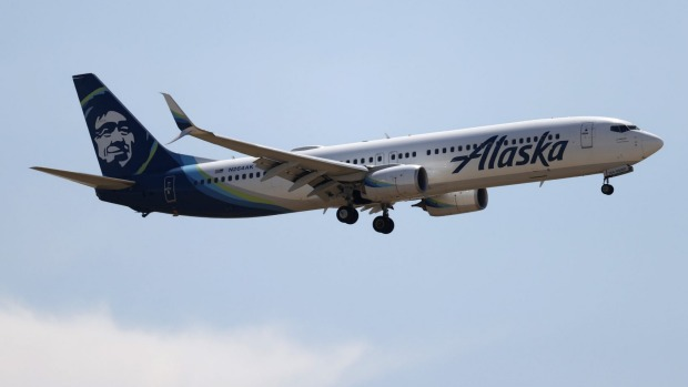 Fourteen passengers have been banned from Alaska Airlines after rowdy behaviour on a flight from Washington DC following ...