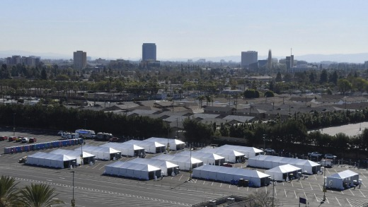 COVID-19 vaccination tents are set up in one of Disneyland's car parks.