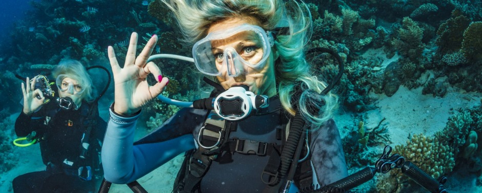 Scuba diver is exploring and enjoying Coral reef  Sea life Two sporting women Underwater photographer iStock image for ...