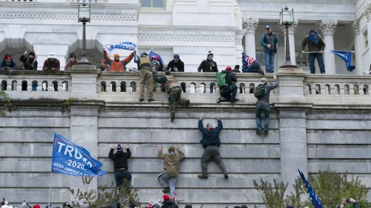 Supporters of President Donald Trump scale the west wall during the attack on the US Capitol in Washington on January 6.