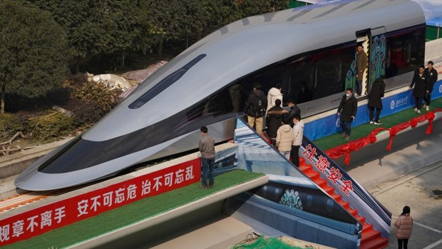 People visit a prototype magnetic levitation train developed with high-temperature superconducting (HTS) maglev ...