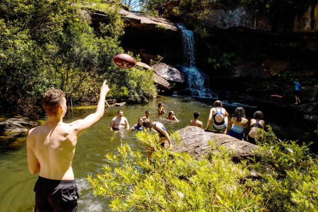 Taking a dip at Upper Gledhill Falls on McCarrs Creek in the Ku-Ring-Gai Chase National Park.