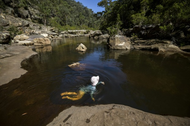 Lydia Anderson cools off in Glenbrook Gorge as temperatures are expected to reach 40 degrees in Sydney's west this weekend.
