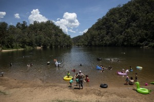 NEWS: People cool off in Bents Basin as temperatures are expected to reach 40 degrees in Sydney's west this weekend. ...