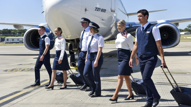 Rex crew at the unveiling of the airline's new uniforms at Sydney Airport on Friday.
