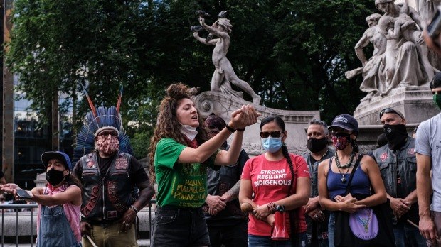 Members of the The Indigenous People's Day New York City Committee protest at the statue of Christopher Columbus last ...