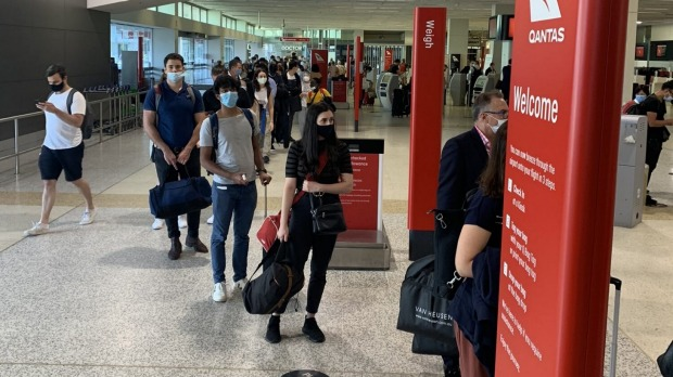 Passengers queue at Melbourne Airport on Friday afternoon.