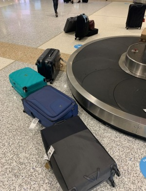 Luggage fallen from the overloaded baggage carousel at Sydney Airport.