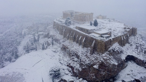 Snow covers the ancient Acropolis hill in Athens.