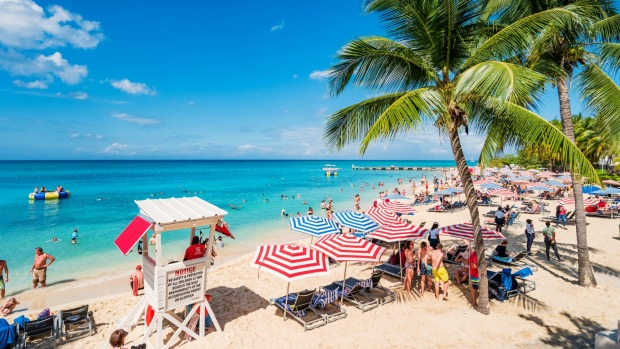 Tourists at a beach in Montego Bay, Jamaica.