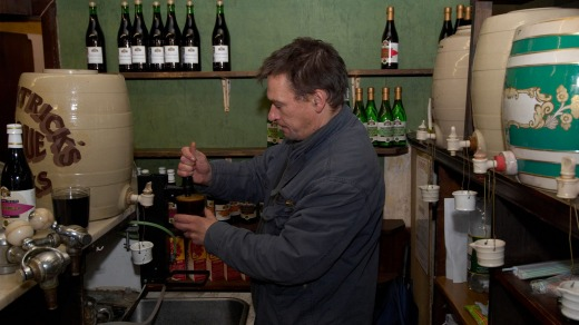 A man pours cordial drinks at Fitzpatrick's, Britain's last temperance bar.