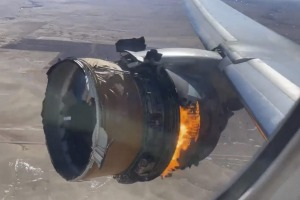 The engine of United Airlines Flight 328 is on fire after after experiencing a 'right-engine failure' shortly after ...