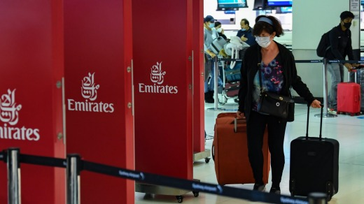 Passengers check in for an Emirates flight departing Sydney Airport in January. Special permission must be obtained from ...