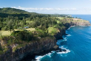 This comfortable house at Anson Bay is perched on a spectacular clifftop between a deep blue sea and a verdantly ...