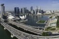 Aerial panoramic vista across Singapore iconic Central Business District skyline, from the busy highways around the ...